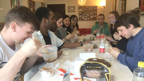 William eating dinner with other students and teachers at LTL Beijing