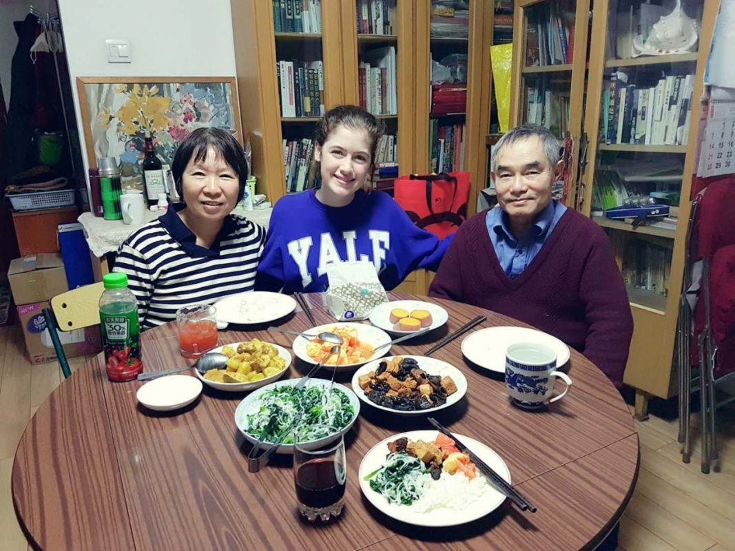 Student eating dinner together with host family in dining room
