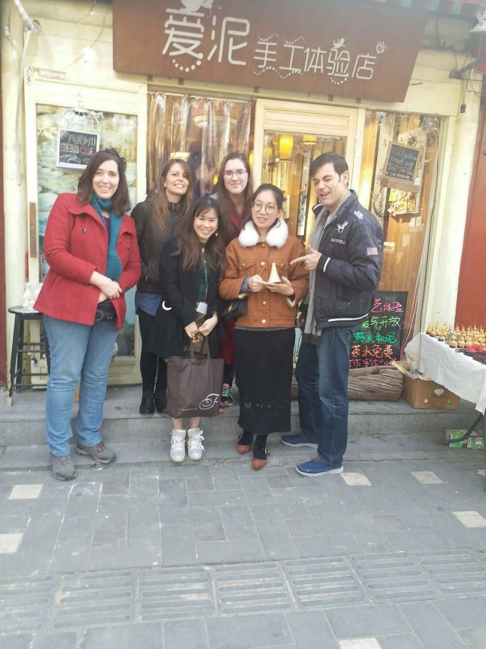 Alana with friends, outside a small restaurant in Beijing