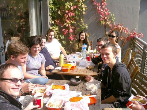Students and staff having lunch together in the sun on the LTL Beijing balcony