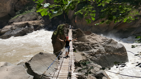 Standing in the middle of Tiger Leaping Gorge, feeling the water move the rock!