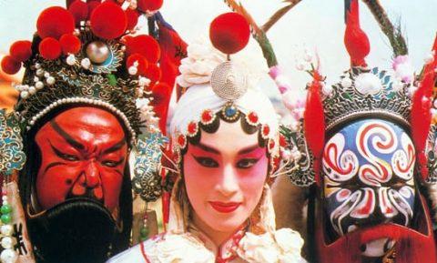 Three Beijing opera actors in masks and makeup