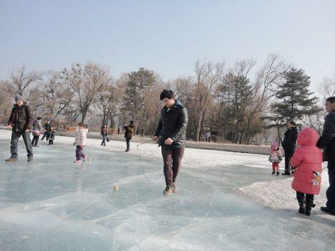 Enjoying the frozen lakes in Chengde Winter