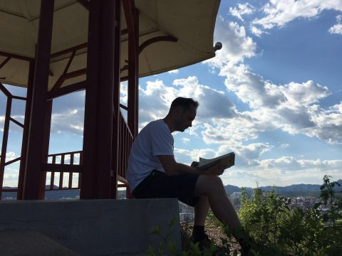 Student sitting outside in Chengde learning Chinese