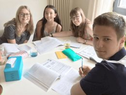 Four teenage students having Chinese class at LTL Beijing