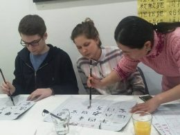 Noah and Anna learning calligraphy