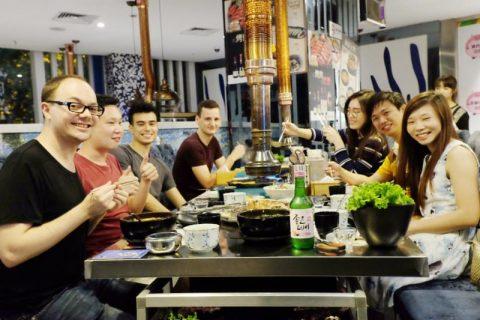 Students and staff enjoying Korean BBQ together