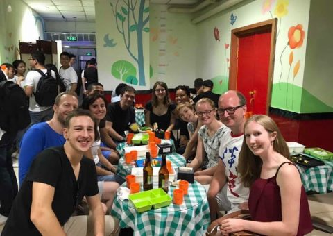Group of LTL students and staff waiting for a table at Hai Di Lao hot pot in Beijing