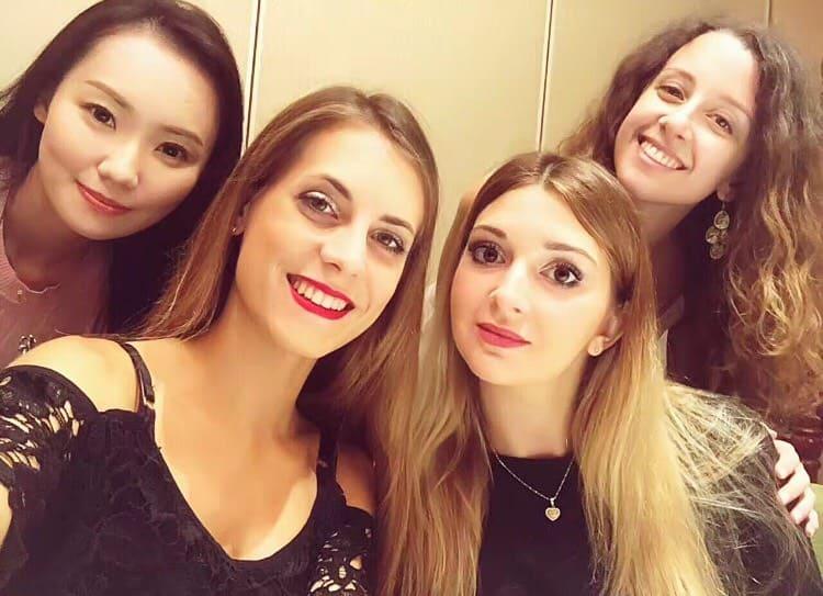 Selfie of four students at a Beijing duck restaurant in Beijing.