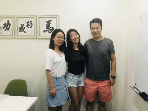 Priscilla together with two of her teachers in classroom at LTL Shanghai