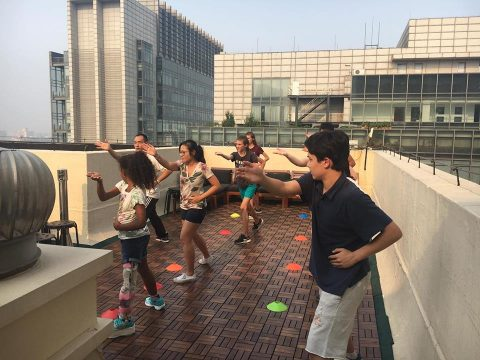 Students doing taiqi at the LTL School rooftop in Beijing