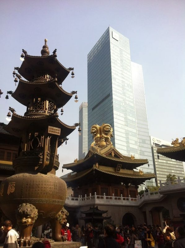 Classic temple and modern high rise building in China