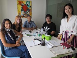Teacher Lucy leading a small group Mandarin class in Beijing with four students.