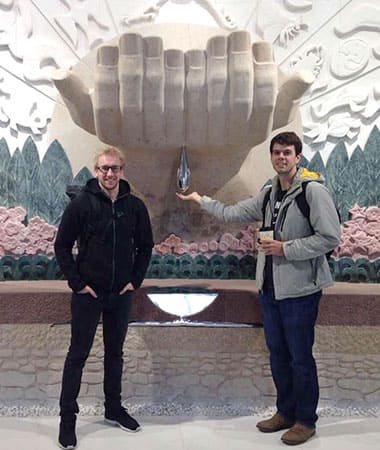 Two students posing in the hall of Beijing museum