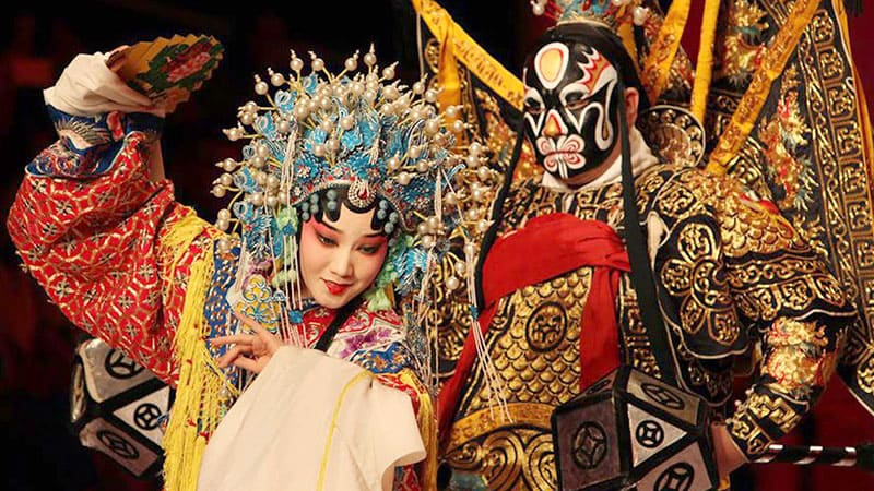 Two actors in masks performing Beijing opera