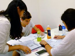 Teacher and two students having Chinese class in Shanghai