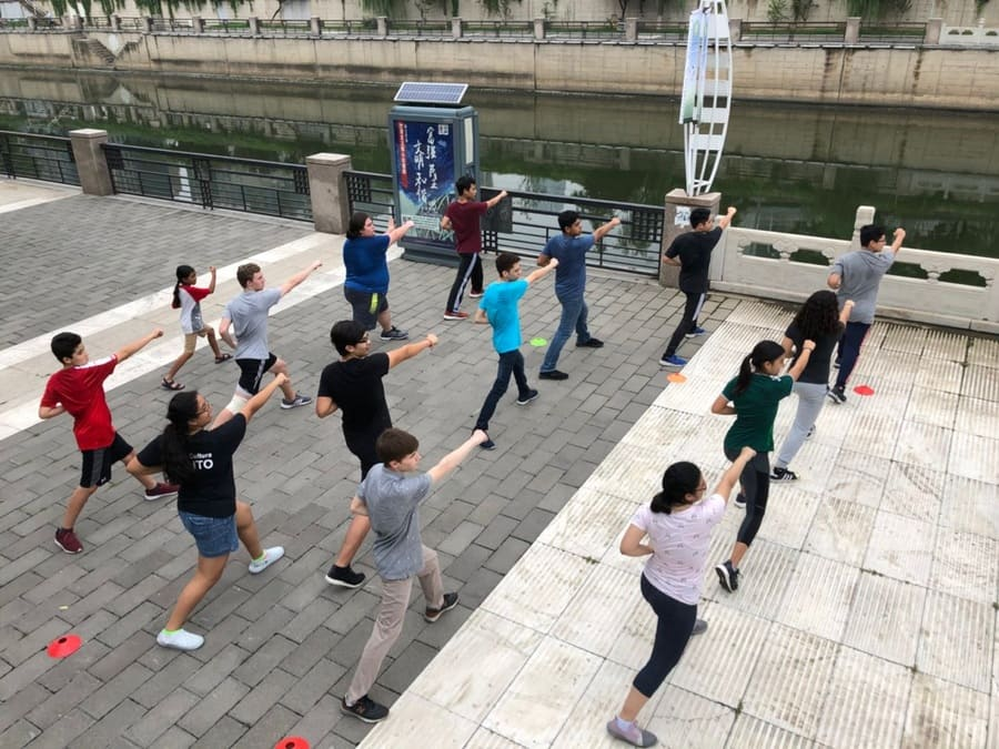 Summer Camp Students learning Tai chi Mexican students practicing taiqi in Beijing, China