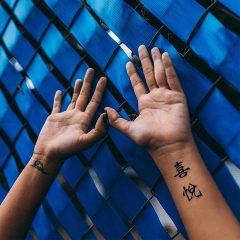 joy in Chinese tattoo
