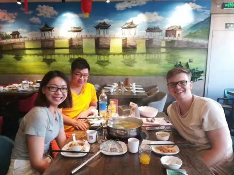 Zander enjoying dinner at restaurant with Angelina from the LTL Beijing Team